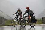 Father and son biking over a pass in the Alps near Lauterbrunnen, Switzerland. .  John offers private photo tours in Denver, Boulder and throughout Colorado, USA.  Year-round. .  John offers private photo tours in Denver, Boulder and throughout Colorado. Year-round.