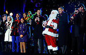 United States President Barack Obama, the First Family, Santa Claus and others sing during the 2011 National Christmas Tree Lighting on the Ellipse in Washington, DC, on Thursday, December 1, 2011.     .Credit: Roger L. Wollenberg / Pool via CNP