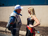 Jun 3, 2018; Joliet, IL, USA; NHRA funny car driver John Force (left) with daughter Courtney Force during the Route 66 Nationals at Route 66 Raceway. Mandatory Credit: Mark J. Rebilas-USA TODAY Sports