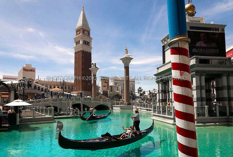 5/13/2015&mdash;Las Vegas, Nevada, USA<br /> <br /> The Venetian Resort Hotel Casino is a five-diamond luxury hotel and casino resort situated between Harrah's and The Palazzo on the east side of the Las Vegas Strip in Paradise, Nevada, United States, on the site of the old Sands Hotel. Designed by KlingStubbins, the hotel tower contains 36 stories and rises 475 feet (145 m). The Venetian is owned and operated by the Las Vegas Sands Corporation. The Venetian also serves as the seat of the corporate headquarters for its parent company.<br /> <br /> Since the Palazzo opened in 2008, the Venetian resort complex is (together with the adjacent Sands Expo Convention Center and The Palazzo Hotel and Casino Resort) the world's largest hotel, with 4,049 rooms, 3068 suites, and a 120,000-square-foot (11,000 m2) casino.<br /> <br /> Photograph by Stuart Isett<br /> &copy;2015 Stuart Isett. All rights reserved.