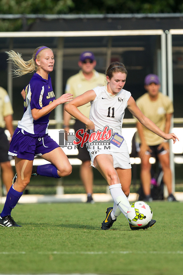 Maddie Huster (11) of the Wake Forest Demon Deacons controls the ball during first half action against the James Madison Dukes at Spry Soccer Stadium on August 29, 2014 in Winston-Salem, North Carolina.  The Dukes defeated the Demon Deacons 2-1.   (Brian Westerholt/Sports On Film)