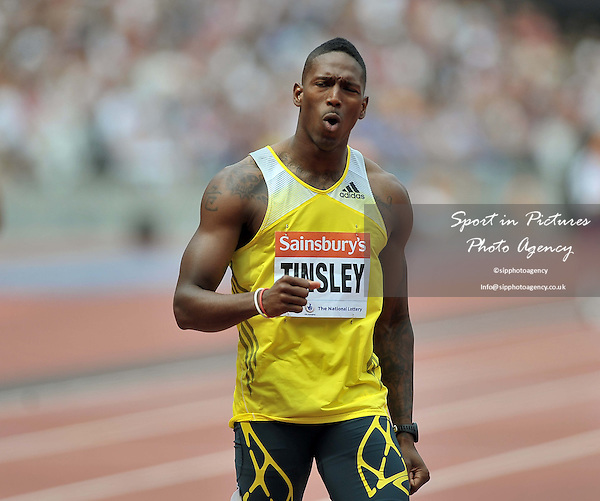 Michael Tinsley (USA) celebrates winning the mens 400m hurdles. Sainsburys Anniversary Games. IAAF Diamond League. Olympic Stadium. Queen Elizabeth Olympic Park. Stratford. London. UK. 27/07/2013. MANDATORY Credit Garry Bowden/SIPPA - NO UNAUTHORISED USE - 07837 394578