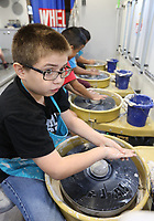 NWA Democrat-Gazette/DAVID GOTTSCHALK Carlos Mancia, a fifth grade student at John Tyson Elementary School, works a small bowl Monday, September 9, 2019, inside the Community Creative Center's Wheel Mobile Traveling Art Studio parked at the school in Springdale. Students from Valarie Traylor's art classes have the opportunity make small bowls or cups inside the recreational and educational vehicle.