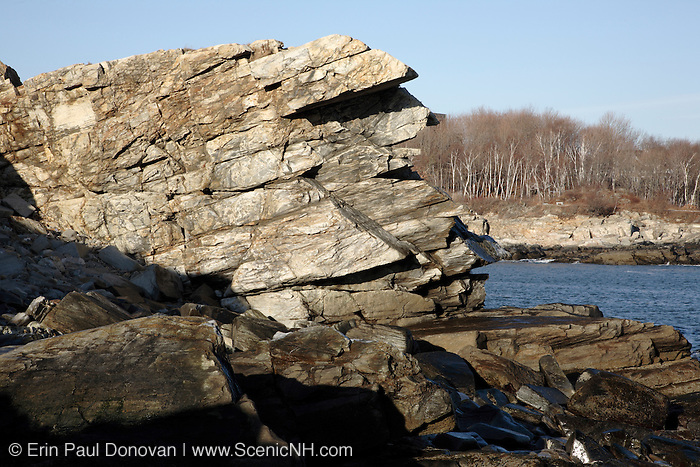 The rocky shoreline at Fort Williams Park during the winter months. Located in Cape Elizabeth, Maine USA,  which is part of the New England seacoast.