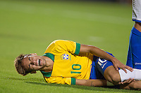 Miami, FL - Saturday, Nov 16, 2013: Brazil vs Honduras during an international friendly at Miami's Sun Life Stadium. Neymar feels the pain after a foul.