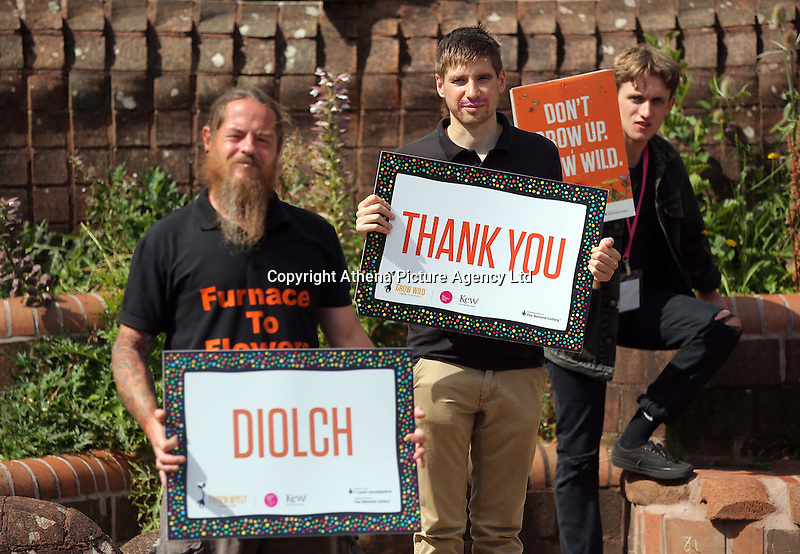 Pictured: People with Diolch and Thank You signs by the mythical beast sculpture by artist Gwen Heeney Saturday 13 August 2016<br />