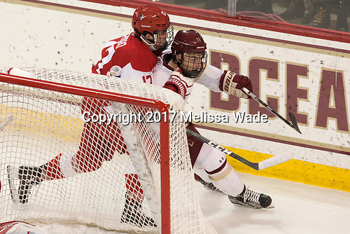Dante Fabbro (BU - 17), Chris Calnan (BC - 11) - The visiting Boston University Terriers defeated the Boston College Eagles 3-0 on Monday, January 16, 2017, at Kelley Rink in Conte Forum in Chestnut Hill, Massachusetts.
