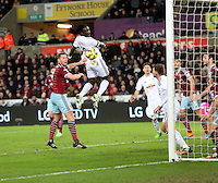 Pictured: Bafetimbi Gomis of Swansea (C) scoring his equaliser Saturday 10 January 2015<br />
