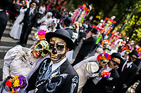 Young couples, costumed as La Catrina, a Mexican pop culture icon representing the Death, walk through the town during the Day of the Dead festivities in Mexico City, Mexico, 29 October 2016. Day of the Dead (Día de Muertos), a syncretic religious holiday combining the death veneration rituals of the ancient Aztec culture with the Catholic practice, is celebrated throughout all Mexico. Based on the belief that the souls of the departed may come back to this world on that day, people gather at the gravesites in cemeteries praying, drinking and playing music, to joyfully remember friends or family members who have died and to support their souls on the spiritual journey.