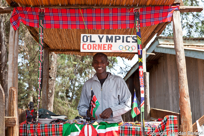 """Thousands of young Kenyan runners hoping to find managers to take them to rich races abroad flock to Iten to train alongside the country's best-known athletes. Johana Kariankei, 20, is one of them - already he runs a half-marathon in 64 minutes, and hopes soon to travel to Europe to compete. In the meantime, to pay his rent, for his food and for his sports training gear, Kariankei, who is from Kenya's Masai tribe, sells Masai bead necklaces and bracelets that he makes himself, often to visiting foreign sports squads. It is, he says, """"a good business"""" but means he has less time to rest and recover after hard training runs."""