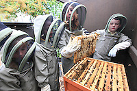 Jo Sparlkes, the gardener at the Charlton Manor Primary School, with 10 and 11 year old children opening a hive that was set up there two years ago. The children took over the activity, as well as the teachers, and the first harvest, following a market study, was packaged and sold.