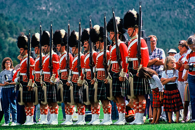 A young girl, dressed in plaid, looks down the line of soldiers of the 78th Highlanders, at the Longs Peak Scottish-Irish Festival in Estes Park, Colorado.