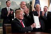 US President Donald J. Trump (C) shows an order he just signed recognizing Golan Heights as Israeli territory, in front of Prime Minister of Israel Benjamin Netanyahu (Back C), in the Diplomatic Recception Room of the White House in Washington, DC, USA, 25 March 2019. Also in the picture is Senior Advisor to the President Jared Kushner (Back L), US Ambassador to Israel David Friedman (2-R) and US Secretary of State Mike Pompeo (R).<br /> Credit: Michael Reynolds / Pool via CNP