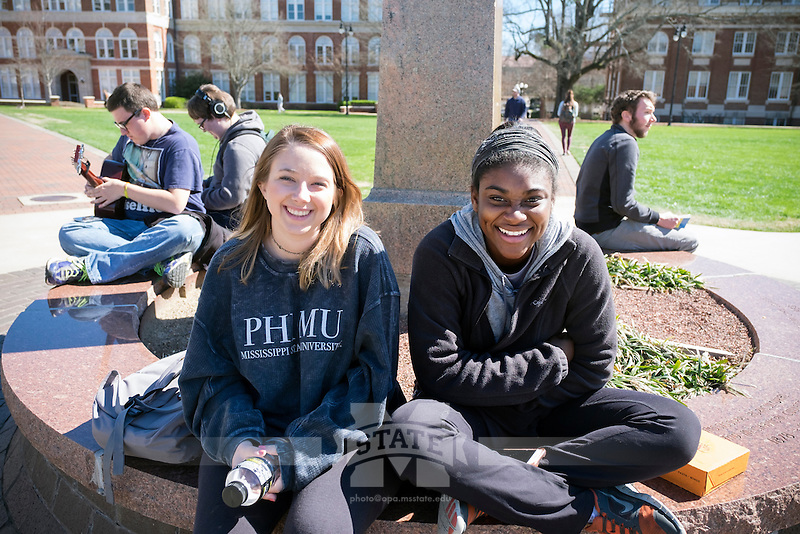 Students and fellow Phi Mu sisters Kirstin Hicks and Veronica Norman hanging out by the Drill Field Stephen D. Lee.<br />  (photo by Megan Bean / &copy; Mississippi State University)