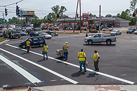 A striping crew adds lines and dividers to an intersection along Westerville Road as construction on the section leading into Westerville nears completion.