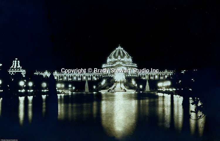 St Louis MO:  A view of the Festival Hall lit up at night.  George Westinghouse and other electric supplier help light the fair.  Electricity was used throughout the fair, from the Ferris Wheel to the DeForest Wireless Telegraph Tower along with many of the rides at the fair.