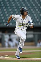 Center fielder Edgardo Fermin (10) of the Columbia Fireflies runs out a batted ball during a game against the Charleston RiverDogs on Wednesday, August 29, 2018, at Spirit Communications Park in Columbia, South Carolina. Charleston won, 6-1. (Tom Priddy/Four Seam Images)