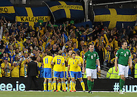6th September 2013; Sweden players celebrate with Anders Svenssonafter he scores his side's second goal. 2014 FIFA World Cup Qualifier, Group C,  Republic of Ireland v Sweden, Aviva Stadium, Dublin. Picture credit: Tommy Grealy/actionshots.ie.