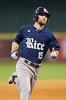 Michael Aquino #15 of the Rice Owls hustles towards third base against the Texas Longhorns at Minute Maid Park on February 28, 2014 in Houston, Texas.  The Longhorns defeated the Owls 2-0.  (Brian Westerholt/Four Seam Images)