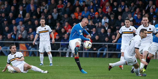 Kenny Miller attempts a shot on goal whilst heavily man marked