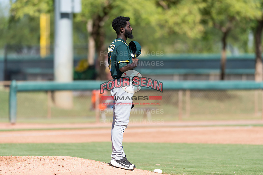 Oakland Athletics relief pitcher Rafael Kelly (61) takes a moment behind the mound during an Instructional League game against the Los Angeles Dodgers at Camelback Ranch on September 27, 2018 in Glendale, Arizona. (Zachary Lucy/Four Seam Images)