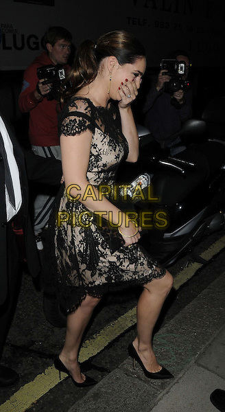 Kelly Brook.at the Philip Treacy s/s 2013 catwalk show, London Fashion Week LFW Day 3, The Royal Courts of Justice, The Strand, London, England..16th September 2012.full length black lace off the shoulder dress clutch bag side profile hand covering face mouth laughing funny .CAP/CAN.©Can Nguyen/Capital Pictures.