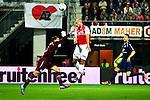 Nederland, Alkmaar, 20 oktober  2012.Eredivisie.Seizoen 2012-2013.AZ-N.E.C..Ruud Boymans van AZ in duel om de bal met Gabor Babos, keeper (doelman) van N.E.C.