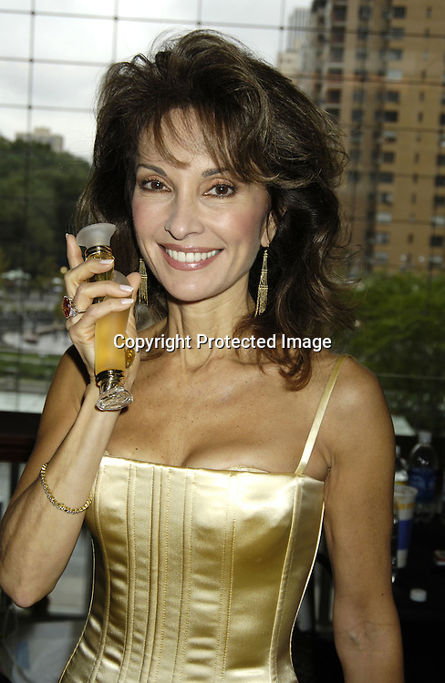 "Susan Lucci ..at The Time Warner Center for the Fragrance Week 2005 NYC "" Stars on Stage Event "" on October 22, 2005 . Susan Lucci was interviewed and met some of her fans. She was promoting her new perfumes "" Invitation"" and "" LaLucci ""...Photo by Robin Platzer, Twin Images.."