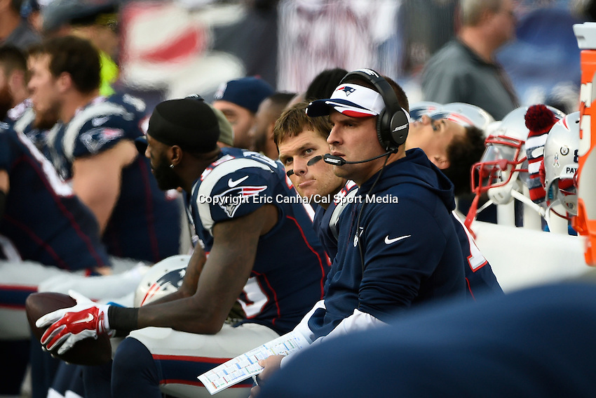 November 23, 2014 - Foxborough, Massachusetts, U.S.- New England Patriots quarterback Tom Brady (12) and offensive coordinator Josh McDaniels sit on the bench during the NFL game between the Detroit Lions and the New England Patriots held at Gillette Stadium in Foxborough Massachusetts. The Patriots defeated the Lions 34-9. Eric Canha/CSM