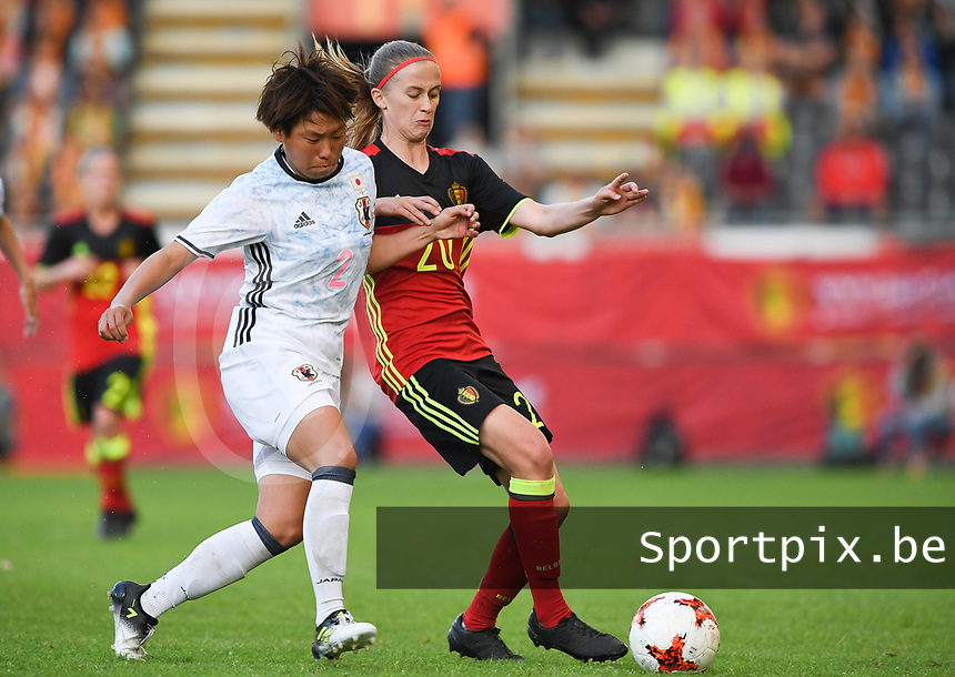 20170613 - LEUVEN ,  BELGIUM : Belgian Julie Biesmans (r) pictured in a duel with Japanese Hikari Takagi (left) during the friendly female soccer game between the Belgian Red Flames and JAPAN , a friendly game in the preparation for the European Championship in The Netherlands 2017  , Tuesday 13 th June 2017 at Stadion Den Dreef  in Leuven , Belgium. PHOTO SPORTPIX.BE | DAVID CATRY