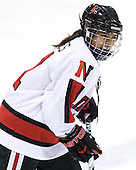 Rachel Llanes (NU - 11) - The visiting University of Connecticut Huskies defeated the Northeastern University Huskies 4-2 (EN) in NU's senior game on Saturday, February 19, 2011, at Matthews Arena in Boston, Massachusetts.