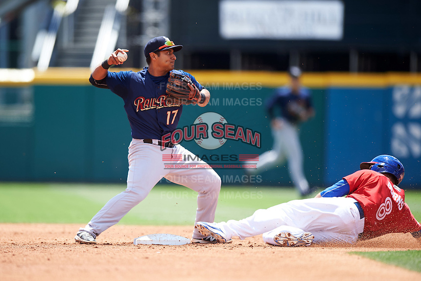 Scranton/Wilkes-Barre RailRiders second baseman Donovan Solano (17) throws to first as Andy Burns (8) slides into second during a game against the Buffalo Bisons on July 2, 2016 at Coca-Cola Field in Buffalo, New York.  Scranton defeated Buffalo 5-1.  (Mike Janes/Four Seam Images)
