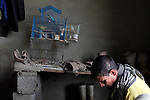 10/10/2014 -- Kirkuk, Iraq -- A bird cage inside a room of Bangladeshi workers in the garage in Kornish street.