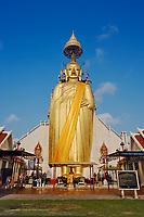 "Giant standing Buddha, ""Luang Pho To"" Wat Intharawihan, Bangkok, Thailand"