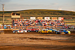 Home town dirt-track racing in the arena of Lind, Wash., at the start of the annual Combine Destruction Derby.