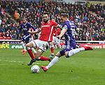 Billy Sharp of Sheffield Utd shot is blocked by Ethan Pinnock of Barnsley during the championship match at the Oakwell Stadium, Barnsley. Picture date 7th April 2018. Picture credit should read: Simon Bellis/Sportimage