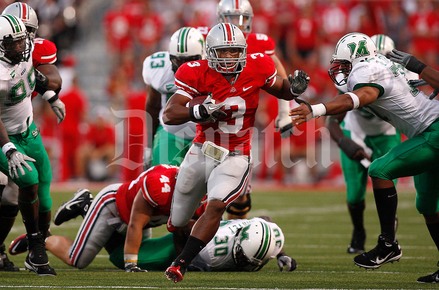 Ohio State running back Brandon Saine (3) eludes the Marshall defense during the first quarter of the NCAA football game at Ohio Stadium on Thursday, September 2, 2010. (Photo by Jonathan Quilter)