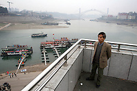 CHINA. Sichuan Province. Chongqing. The Yangtze River which is at its lowest level in 150 years as a result of a country-wide drought. Chongqing is a city of over 3,000,000 people, famed for being the capital of China between 1938 and 1946 during World War II. It is situated on the banks of the Yangtze river, China's longest river and the third longest in the world. Originating in Tibet, the river flows for 3,964 miles (6,380km) through central China into the East China Sea at Shanghai.  2008.