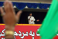 Iranian President Mahmoud Ahmadinejad extends a hand out to one of his supporters who waves at him during a speech in the Iranian city of Ardabil.