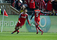 17 September 2011: Toronto FC midfielder Danny Koevermans #14 celebrates his first goal with Toronto FC defender Ashtone Morgan #5 during a game between the Colorado Rapids and Toronto FC at BMO Field in Toronto..Toronto FC won 2-1.