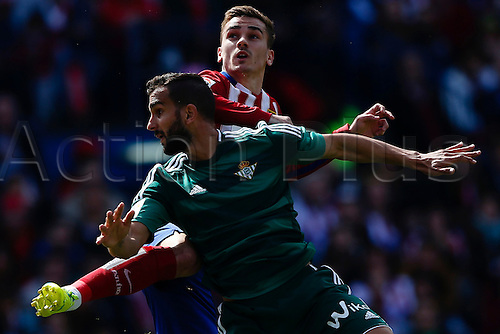 02.04.2016. Madrid, Spain.  Martin Montoya (3) Real Betis wins the header from Antonie Griezmann (7) Atletico de Madrid. La Liga match between Atletico de Madrid and Real Betis at the Vicente Calderon stadium in Madrid, Spain, April 2, 2016 .