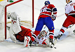 31 March 2010: Carolina Hurricanes' goaltender Cam Ward makes a first period save against Montreal Canadiens left wing forward Andrei Kostitsyn  at the Bell Centre in Montreal, Quebec, Canada. The Hurricanes defeated the Canadiens 2-1 in their last meeting of the regular season. Mandatory Credit: Ed Wolfstein Photo