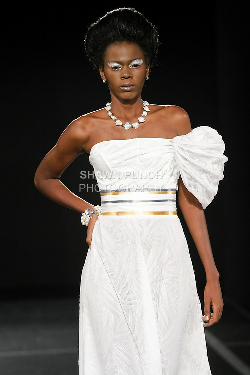 Model walks the runway for the Andres Aquino Spring 2011 runway fashion show, during Couture Fashion Week, September 11, 2010.
