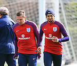 England's Theo Walcott and Phil Jagielka in action during training at the Tottenham Hotspur Training Centre.  Photo credit should read: David Klein/Sportimage