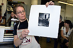 "Printmaker Janet Ballweg shows a print she just made during the 2006 Mid America Print Council conference ""Forging Connections"" at Ohio University on Friday, 9/22/06. The conference runs from September 20-23. Around 700 printmakers, students, curators and other art professionals are expected to attend the biennial event."