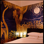 Room number 208 painted by Mexican artist Jet Martinez uses gold leaf detailing in his mural paintings and geometric patterns representing plants.