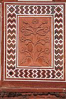 Agra, India.  Taj Mahal Mosque.  Floral Design in Red Sandstone.