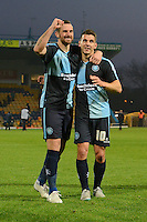 Wycombe Wanderers Paul Hayes and Matt Bloomfield salute the travelling supporters following the Sky Bet League 2 match between Mansfield Town and Wycombe Wanderers at the One Call Stadium, Mansfield, England on 31 October 2015. Photo by Garry Griffiths.