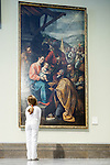 Little girl looking at Juan del Castillo's painting depicting the Adoration of the Magi (1635). Museum of Fine Arts, Seville, Spain