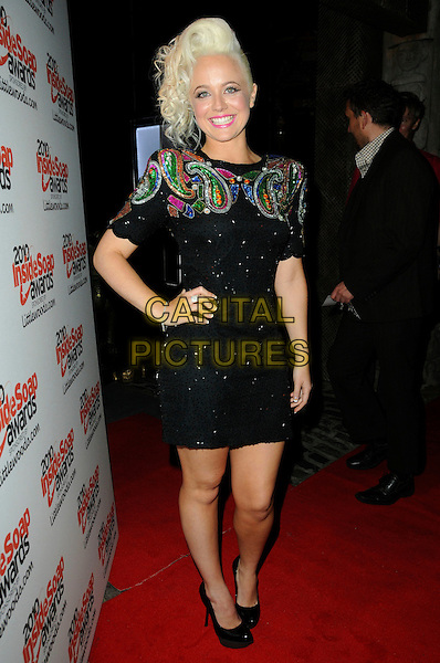 CHARLIE CLEMMOW .Attending the Inside Soap Awards 2010 held at Shaka Zulu, Camden, London, England, UK, September 27th 2010 arrivals full length black dress hand on hip gold beaded pink green shoes shoulder pads paisley patterned embellished .CAP/CAS.©Bob Cass/Capital Pictures.
